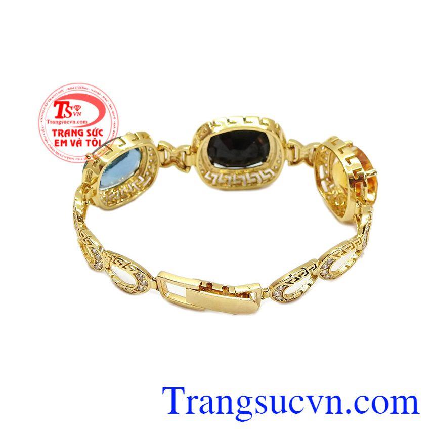 Lắc tay đá quý sang trọng là sự kết hợp từ vàng tây 14k cùng đá sapphir, thạch anh vàng và đá topaz thiên nhiên.
